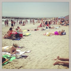 Photo taken at Rockaway Beach by Bonnie C. on 8/11/2013