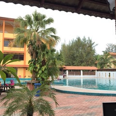 Photo taken at Demong Beach Resort by Fitri H. on 10/14/2015