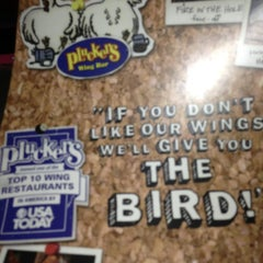 Photo taken at Pluckers Wing Bar by Kristie T. on 1/5/2013