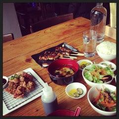 Photo taken at Kushi Izakaya & Sushi by Jie Y. on 12/31/2012