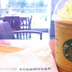Photo taken at Starbucks (สตาร์บัคส์) by Poompoom K. on 6/9/2012