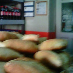 Photo taken at Panaderia el Fenix by Marta G. on 1/25/2012