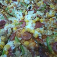 Photo taken at Domino's Pizza by Sema Sıla U. on 3/14/2013