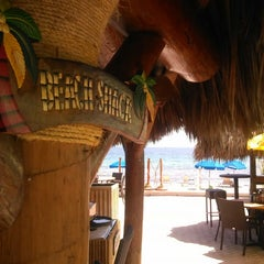 Photo taken at Bamboo Beach Tiki Bar & Cafe by Michael O. on 9/13/2013