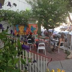 Photo taken at Namaste Cafe by Erin C. on 7/12/2013