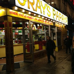 Photo taken at Gray's Papaya by Edwin R. on 1/31/2013