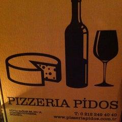 Photo taken at Pizzeria Pidos by Dunya on 4/12/2013