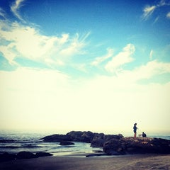 Photo taken at Praia de Itapoá by Djessica D. on 7/27/2013