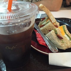 Photo taken at Café DoiTung (คาเฟ่ ดอยตุง) by Ann C. on 9/18/2015