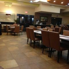 Photo taken at La Siesta Restaurant Bar by Dana G. on 12/25/2012