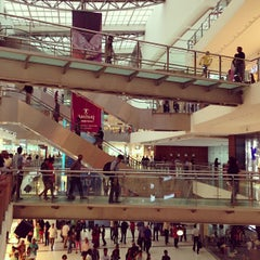 Photo taken at Oberoi Mall by Sunny U. on 6/15/2013