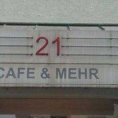 Photo taken at Cafe 21 by Alexander J. on 4/12/2014