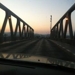 Photo taken at Pont de Bizerte by Jihene M. on 7/22/2013