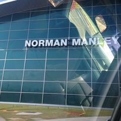 Photo taken at Norman Manley International Airport (KIN) by Metra K. on 4/8/2013