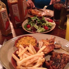 Photo taken at Nando's by Grover B. on 7/4/2013
