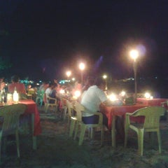 Photo taken at Seaslug's Beach Bar And Resto by Third M. on 1/24/2013