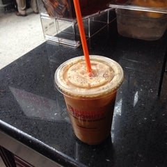 Photo taken at Dunkin' Donuts by Emily M. on 7/16/2014