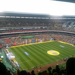 Photo taken at Estadio Azteca by Ivette C. on 5/26/2013