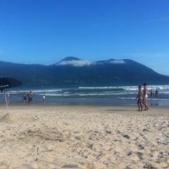Photo taken at Praia de Guaecá by Nicole E. on 1/5/2013