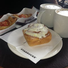 Photo taken at Starbucks by Elena E. on 7/12/2013