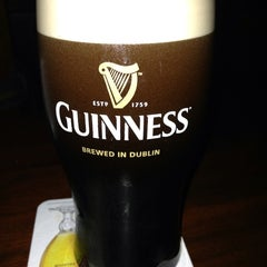 Photo taken at Fadó Irish Pub & Restaurant by Wendy F. on 6/1/2013