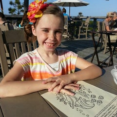 Photo taken at Fins On The Beach by Ashley L. on 4/7/2013