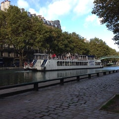 Photo taken at Canal Saint-Martin by Petr K. on 10/23/2013