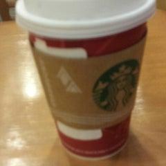 Photo taken at Starbucks by Nick B. on 12/9/2013