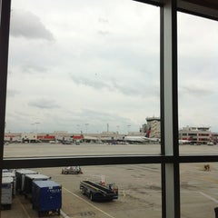 Photo taken at Gate T12 by Adzril A. on 10/14/2012