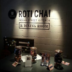 Photo taken at Roti Chai by Angela S. on 6/14/2013