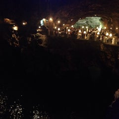 Photo taken at Grotta Palazzese by Andrea C. on 9/11/2014