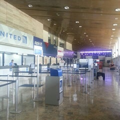 Photo taken at Aeropuerto Internacional Monseñor Óscar Arnulfo Romero (SAL) by Ivan R. on 5/25/2013