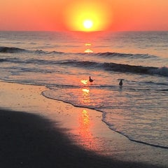 Photo taken at Rockaway Beach by Nate F. on 9/28/2014