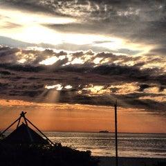 Photo taken at Praia Brava by Antonio D. on 7/15/2013