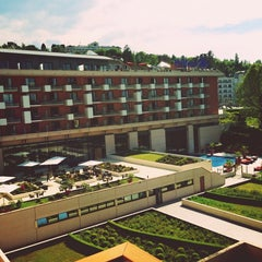 Photo taken at Hilton Evian-les-Bains by Cas H. on 6/6/2013