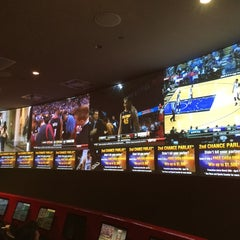 Photo taken at Race & Sports Book by Whitney S. on 3/27/2014