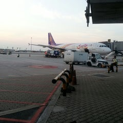 Photo taken at Gate A4 by thummanoon k. on 3/23/2013