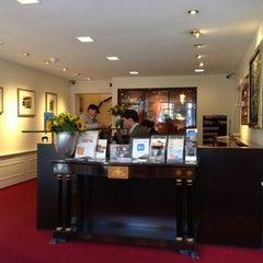 Photo taken at Ambassade Hotel by Brian P. on 3/27/2013