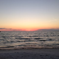 Photo taken at Coquina Beach by Hayley S. on 10/18/2013