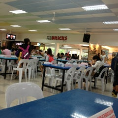Photo taken at The Red Bricks Cafeteria (formerly Canteen 1) by Ee W. on 3/12/2013