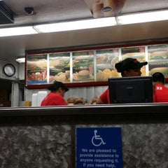 Photo taken at Fabulous Charbroiled Burgers #1 by Dre T. on 7/6/2014