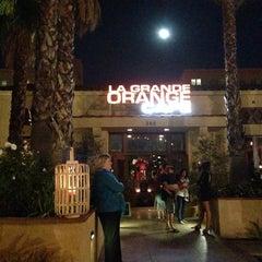 Photo taken at La Grande Orange Cafe by Calvin L. on 10/28/2012