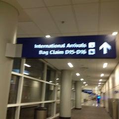 Photo taken at Terminal E by Dennis E. on 3/12/2013