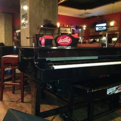 Photo taken at Lucille's Piano Bar & Grill by Marie P. on 2/24/2013