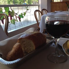 Photo taken at Osteria by Mandy E. on 7/23/2014
