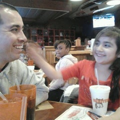 Photo taken at Hooters by Iliana R. on 4/1/2012