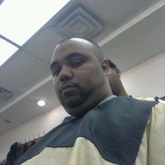Photo taken at Dominguez Barbershop by Julio R. on 4/5/2012