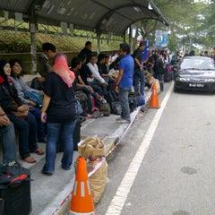 Photo taken at Traffic Light Gate UiTM Seksyen 7 by Aizat E. on 10/8/2011