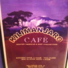 Photo taken at Kilimanjaro Cafe by Vic M. on 4/12/2011