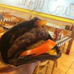 Photo taken at Wholly Cow Burgers by Chris C. on 4/9/2012